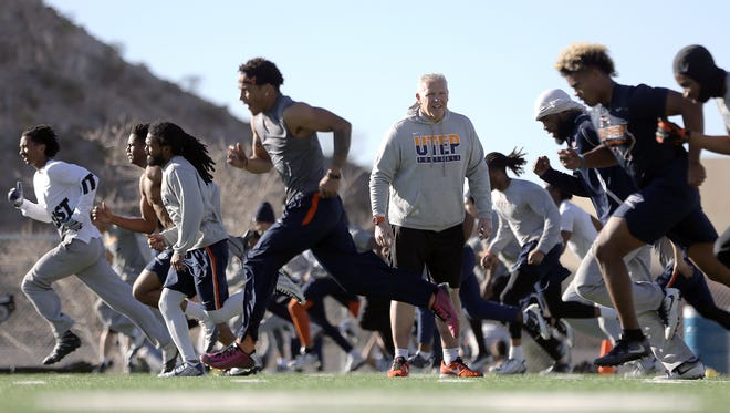 UTEP's new head football coach Dana Dimel puts his team through a final day of conditioning before spring football begins Monday.