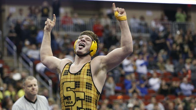 Southeast Polk's Ethan Andersen, seen here celebrating his win in the finals of the 3-A 220-pound match in February's state tournament, won a Folkstyle Nationals title Friday.