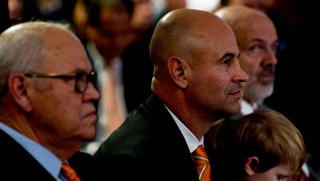 Jeremy Pruitt listens to his introduction as Tennessee's next head football coach at the Neyland Stadium Peyton Manning Locker Room in Knoxville, Tenn. on Thursday, December 7, 2017.