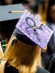 Prince is honored with a decorated mortar board at