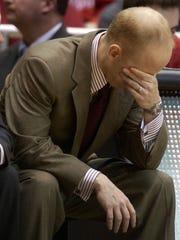 Mick Cronin covers his face near the end of UC's game after one of his players fouled a Pittsburgh player in a 67-51 loss on Jan. 24, 2007.