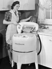 "Wringer (""mangler"") washing machine."