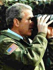 President George Bush during a visit to South Korea. Note the flag patch on his jacket sleeve.