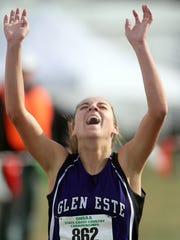 Michelle Thomas of Glen Este celebrates as she crosses