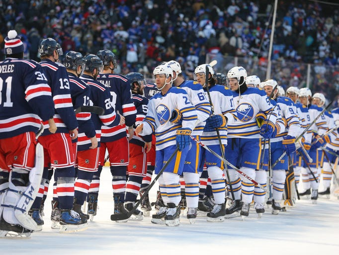The New York Rangers and Buffalo Sabres shake hands