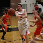 Westfall's Regan Stonerock passes the ball in the Mustangs' season opener against Wheelersburg. The Mustangs are expected to contend for a conference title in 2015-16.