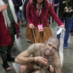 Thousands of people attended day two of the 3rd annual Salt Lake Comic Con Fan Xperience in cosplay outfits on Friday, March 25, 2016.