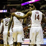 FSU protects home court, falls on road