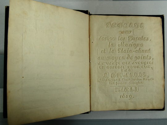 """This """"ultra rare"""" copy of a book by Louis Braille that"""