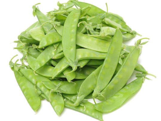 Green Snow Peas, Organic Vegetables Stacked Together, Isolated on White