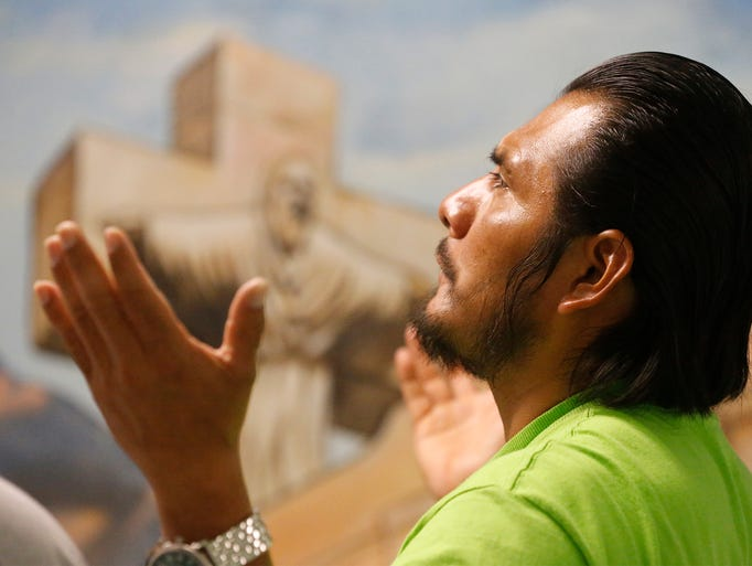 Marco Gomez Lopez prays during Mass on Wednesday morning