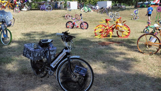 Dozens of bicycle-based art creations were on display in Finish Line Village at the 35th Annual Hotter'N Hell Hundred. The exhibit was coordinated by the Wichita Falls Alliance for Arts and Culture.