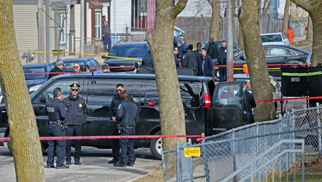 Police investigate the shooting death of a City of Milwaukee building inspector Wednesday near N. 23rd and W. Cherry streets. Police Chief Edward Flynn is at left with sunglasses.