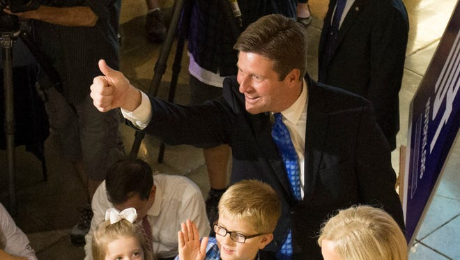 Phoenix Mayor Greg Stanton gives a thumbs up to supporters at DeSoto Central Market in Phoenix on Aug. 25. Stanton is backing 2016 Democratic front-runner Hillary Clinton for president.