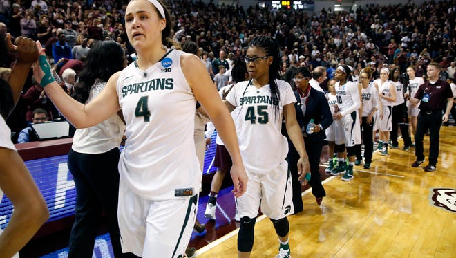 Michigan State center Jasmine Hines (4) and teammates congratulate Mississippi State after losing in the second-round of the NCAA tournament Sunday in Starkville, Miss.