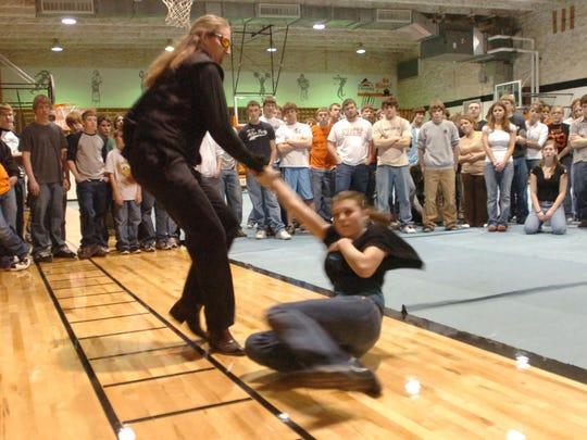 Cascade High School art teacher Stormy Schwindt demonstrated an advanced dance move in 2007 with Gwen Mann as students at Centerville High watched.