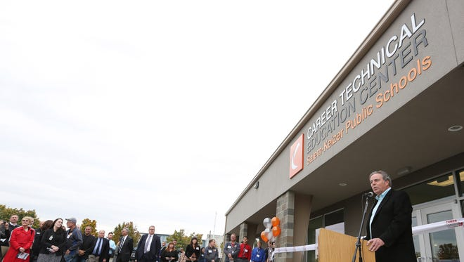 Chuck Lee,  president of Mountain West Career Technical Institute, greets guests at the dedication for the Career Technical Education Center Friday, Oct. 9, 2015, in Salem.