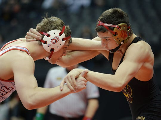 Rocky Mountain High School's Josh Betts, right, is one of 21 wrestlers selected to the Coloradoan's All-Area team.