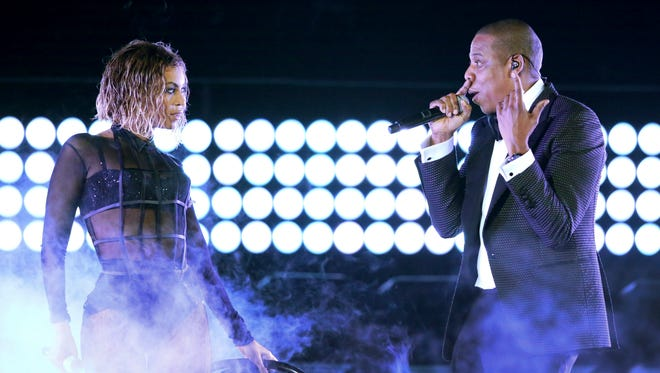 """Beyonce and Jay Z performing """"Drunk in Love"""" at the 56th annual Grammy Awards in Los Angeles on Jan. 26. The couple performed Saturday night at Citizens Bank Park in Philadelphia, as part of their On the Run tour."""