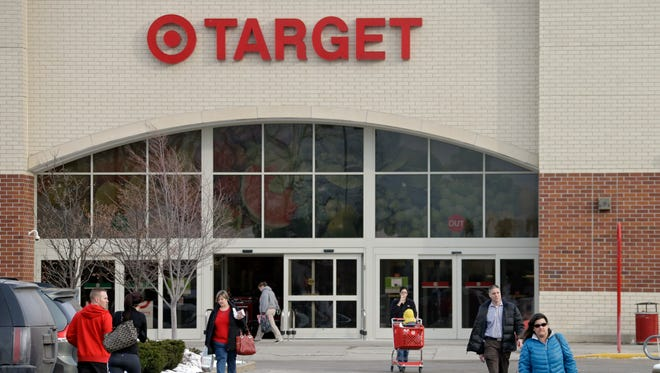 Shoppers leave a Target store in North Olmsted, Ohio, on Dec. 19, 2013.