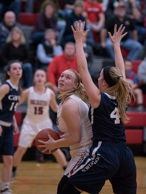 Buckeye Central's Courtney Pifher battles for position in the paint.