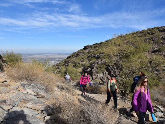 Hikers taking the Holbert Trail to Dobbins Lookout