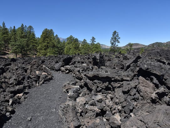 The hike is on rough cinders and black sand.