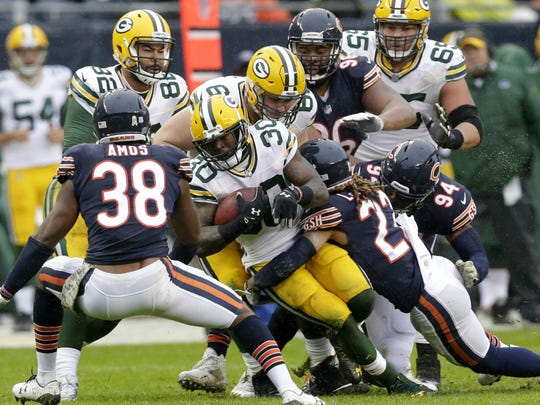 PACKERS13 PACKERS  - Green Bay Packers running back Jamaal Williams (30) runs hard during the 3rd quarter of Green Bay Packers 26-13 win against the Chicago Bears at Soldier Field in Chicago, Ill. on Sunday, November 12, 2017.  Mike De Sisti / Milwaukee Journal Sentinel