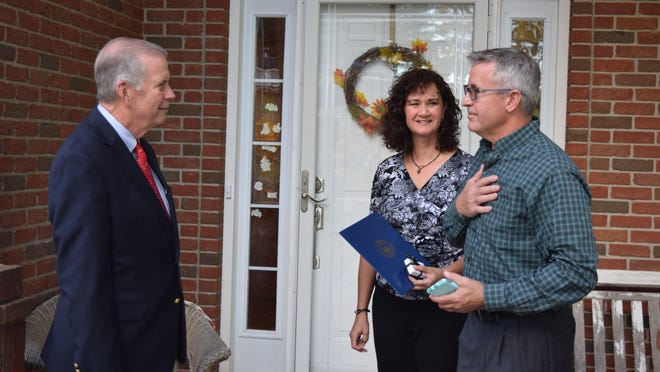 U.S. Rep. Tim Walberg, left, speaks with Tim and Michelle Haylett of Hillsdale, who have been recognized as the 2020 Angels in Adoption from Michigan's 7th Congressional District.