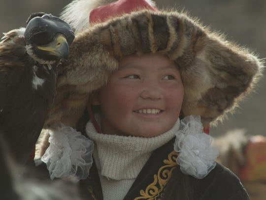 """Aisholpan, the star of Otto Bell's new documentary """"The Eagle Huntress."""""""