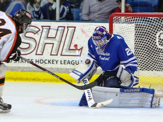 Catholic Central goaltender Alec Calvaruso (right)
