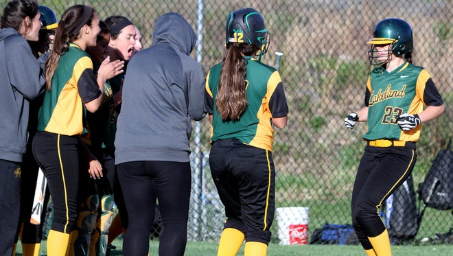Lakeland's Sarah Fritz is congratulated by teammates after her seventh inning solo home run gave Lakeland a two run lead over Hendrick Hudson in a varsity softball game at Hendrick Hudson April 27, 2016. Lakeland defeated Hendrick Hudson 2-0.