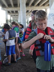 A Youth Sailing Foundation sailor clips his new water