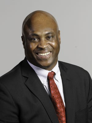 Hollis R. Towns, executive editor and vice president/news