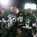 Photos: MSU wins division with 55-16 win over Penn State