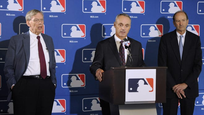 """From left, Major League Baseball Commissioner Allan H. """"Bud"""" Selig, Major League Baseball chief operating officer Rob Manfred and St. Louis Cardinals chairman Bill DeWitt Jr., chairman of a baseball commissioner succession committee, speak to reporters after team owners elected Manfred as the next commissioner of Major League Baseball during an owners quarterly meeting in Baltimore Thursday, August 14, 2014."""
