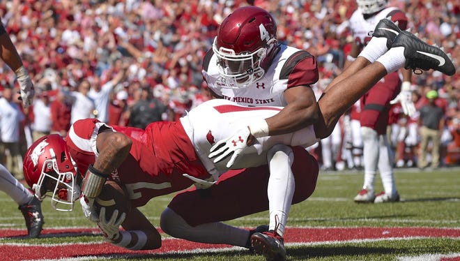 Razorback wide receiver Jonathan Nance (7) catches a touchdown pass Saturday afternoon against New Mexico State. Nance caught six passes for 58 yards and two touchdowns in the Hogs' 42-24 victory.