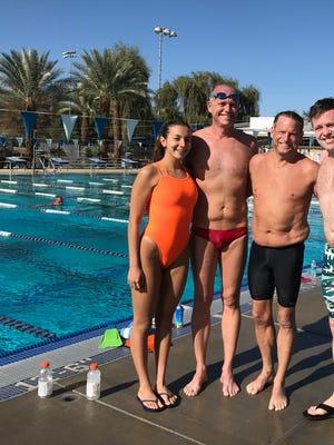 Returningswimmers Abby Kartzinel, Steve Erickson, Dana Krueger, Robert Breitel beam afterswimming roughly six miles each.