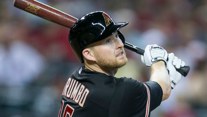 Diamondbacks' Mark Trumbo fouls off a 3-1 pitch before hitting a home run against the Rockies at Chase Field on Aug. 9, 2014.