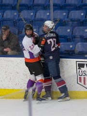 Youngstown's John Larkin (left) gets tangled up along the boards with Team USA U18's Jake Pivonka.