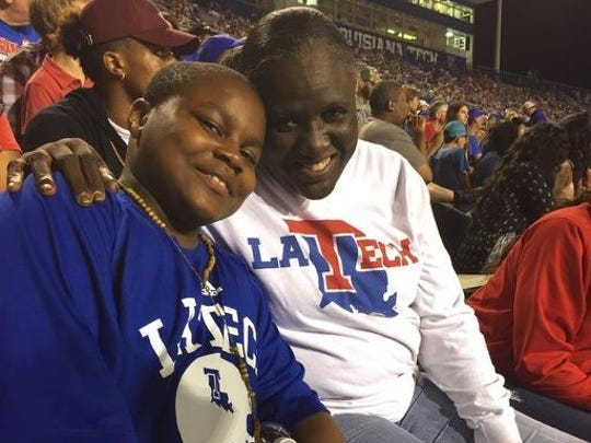 Deangelo Brown, left, and Debra Dancy share a moment at Louisiana Tech's game in October against Rice.