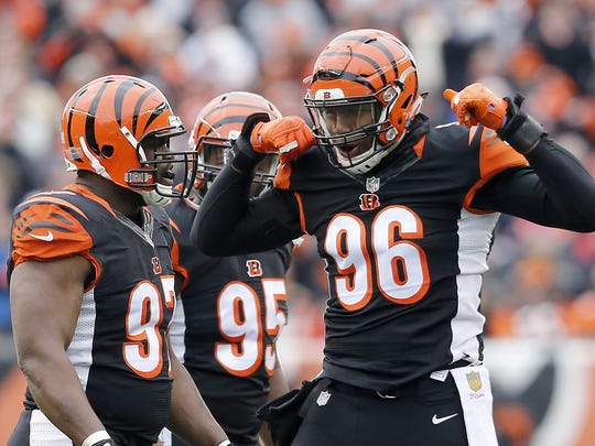 Cincinnati Bengals defensive end Carlos Dunlap celebrates with Geno Atkins after a sack in the first quarter against Baltimore.