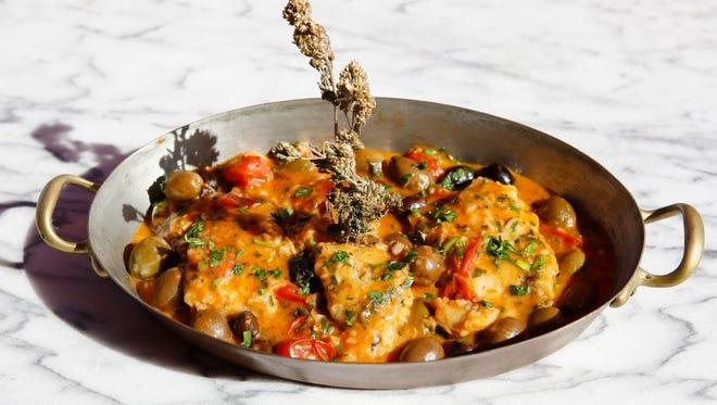 Chef-owner Giovanni Scorzo of Andreoli's Italian Grocer prepares Cenone di Natale Baccala in Umido Con Patate in Scottsdale, AZ.