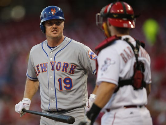 New York Mets right fielder Jay Bruce (19) talks to Cincinnati Reds catcher Tucker Barnhart (16) in the second inning during the MLB National League baseball game between the New York Mets and the Cincinnati Reds, Tuesday, Sept. 6, 2016, at Great American Ball Park in Cincinnati.