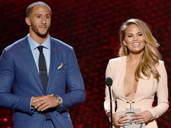 Colin Kaepernick, left, and Chrissy Teigen present the award for best female athlete at the ESPY Awards at the Nokia Theatre on Wednesday, July 16, 2014, in Los Angeles.