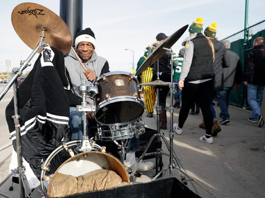 Keith Hudson plays his drum set as fans walk past to attend a game at Lambeau Field on Dec. 3, 2017 in Green Bay, Wis. Sarah Kloepping/USA TODAY NETWORK-Wisconsin