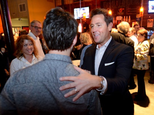 Mayor Ashton Hayward greets supporters at Vinyl Music Hall on Tuesday as he is re-elected for a second term.
