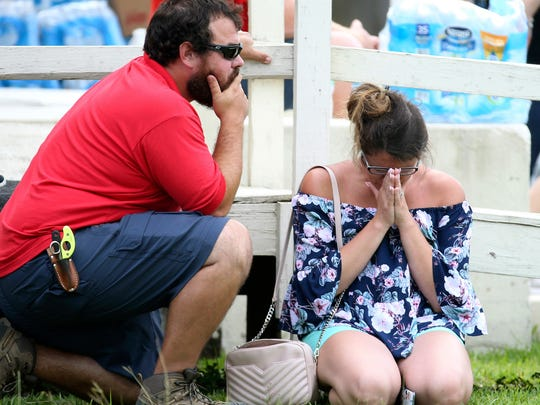 A woman prayed outside the Santa Fe ISD Alamo Gym where students and faculty were being brought after a shooting at Santa Fe High School on Friday, May 18, 2018, in Santa Fe, Texas.