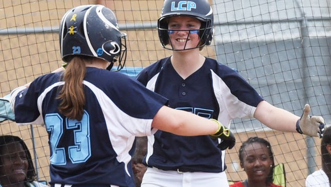 Loyola's Grace Hensley congratulates a Claire Riddick after she scores during their game against Vanderbilt Catholic in the LHSAA Division II state softball playoff game Friday afternoon.