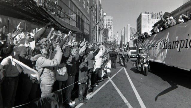 Fans line the streets as the Phillies World Series parade makes its way through Philadelphia.